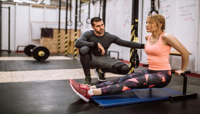 Couple training at the gym | DNAfit Blog