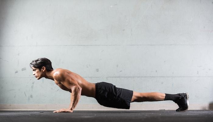 Man doing push ups on the floor | DNAfit Blog