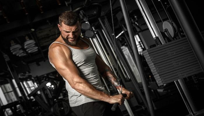 Man doing push downs at the gym | DNAfit Blog