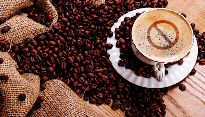 Coffee beans and a cup of coffee | DNAfit Blog