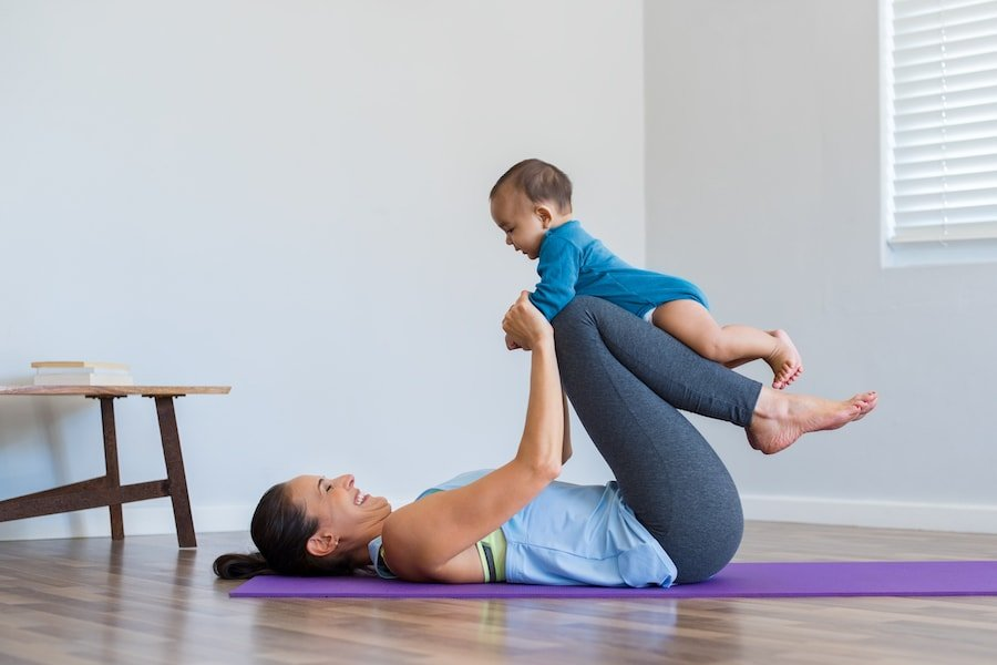 Mum exercising with baby | DNAfit Blo
