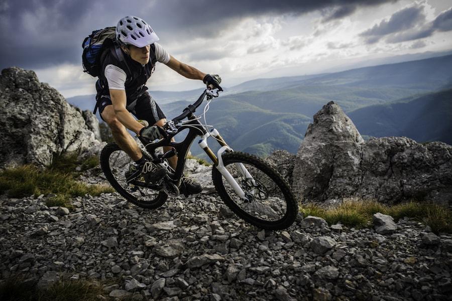 Man mountain biking | DNAfit Blog