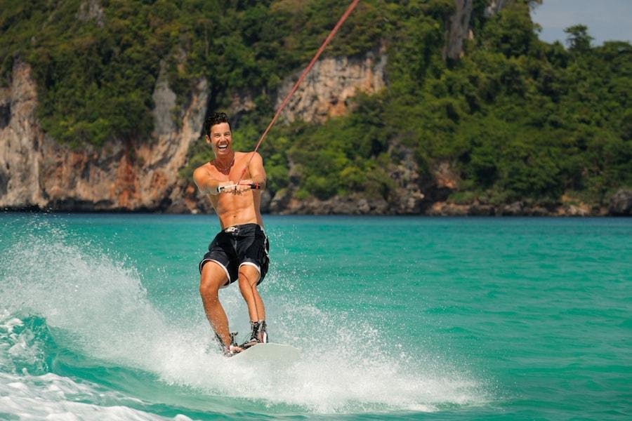 Man wake boarding on holiday | DNAfit Blog