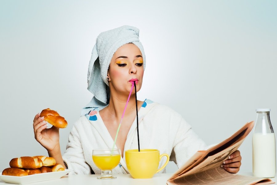 Woman overeating at breakfast | DNAfit Blog