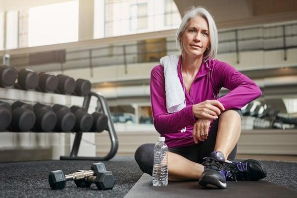 Older woman sitting at the gym   DNAfit Blog