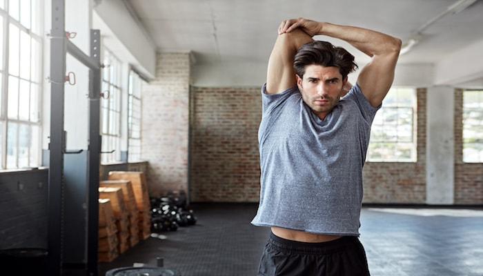 Man stretching after a workout | DNAfit Blog