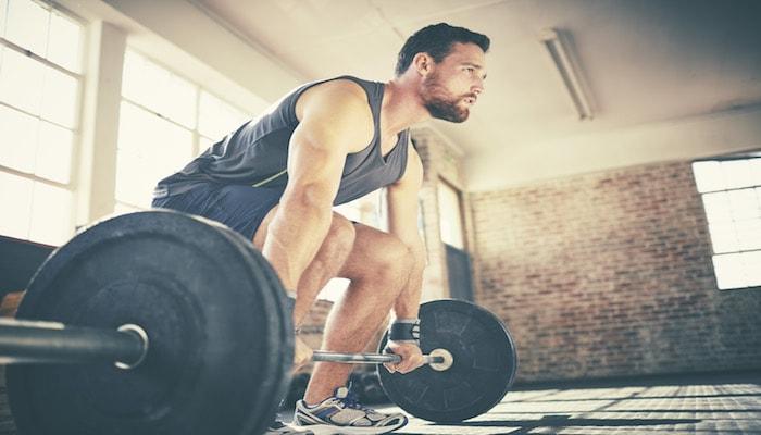 Man weightlifting at the gym | DNAfit Blog