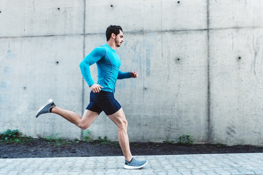 Man running on the pavement   DNAfit Blog