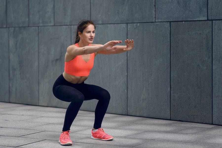 Woman doing squats   DNAfit Blog