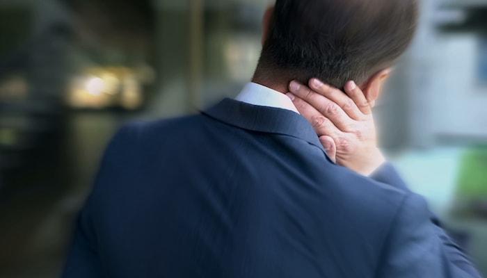 Man stretching his neck   DNAfit Blog