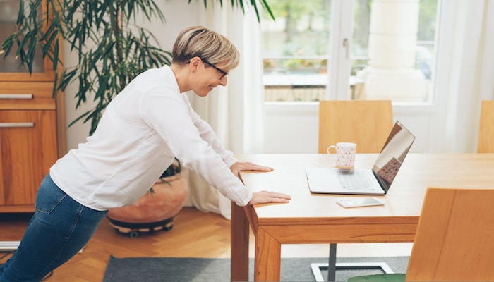 woman doing standing push ups   DNAfit Blog