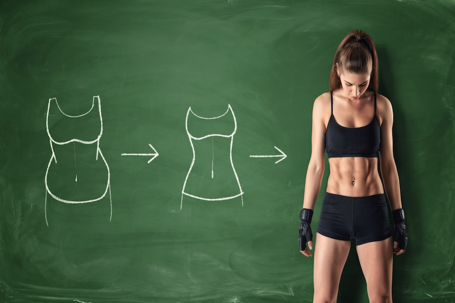 Woman standing in front of chalk board | DNAfit Blog