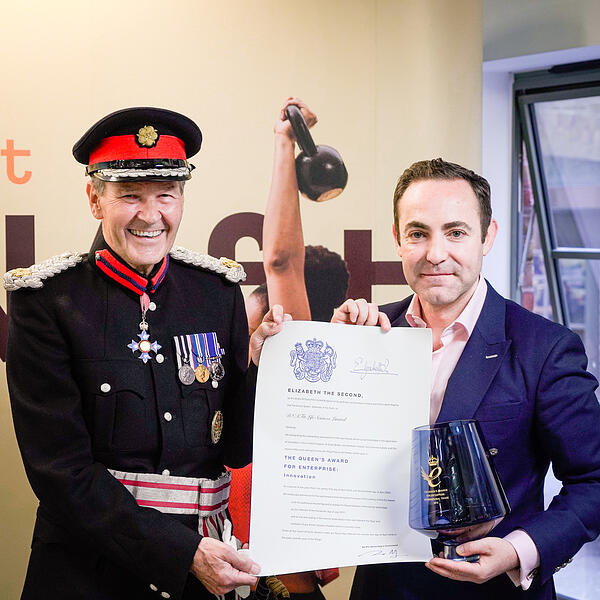 Deputy Lieutenant Sir Ian Johnston presenting the awards to Avi Lasarow, co-founder and CEO of DNAfit on behalf of The Queen.