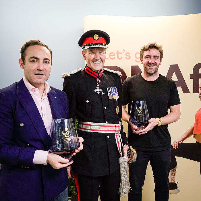 Avi Lasarow, Deputy Lieutenant Sir Ian Johnston and Andrew Steele received two fine pieces of crystal, on behalf of Her Majesty, together with the Scroll of the Queen's Award.
