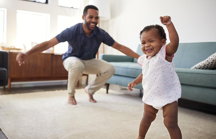 Father dancing with his baby daughter in their house | DNAfit Blog
